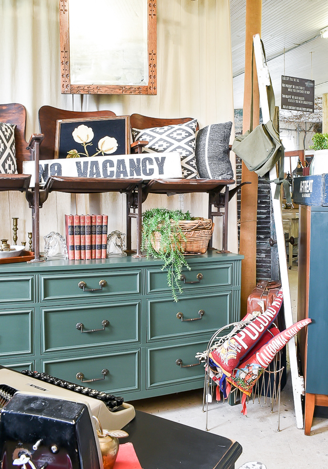 Dark green dresser and vintage theatre seats