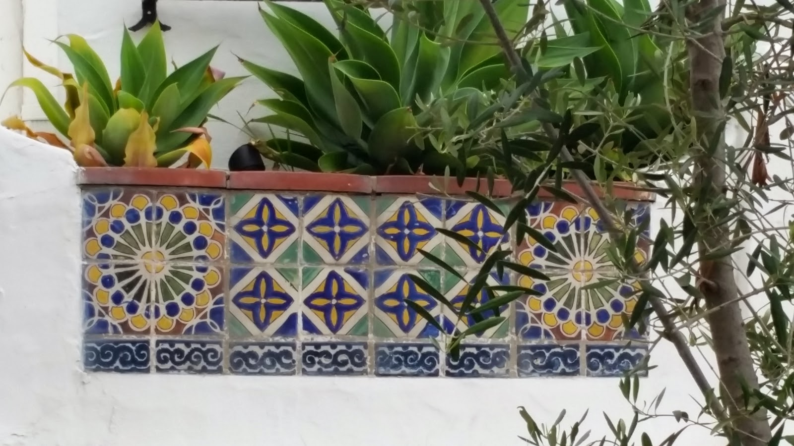 Tiles patterns on this planter box are Spanish and Moorish influenced.
