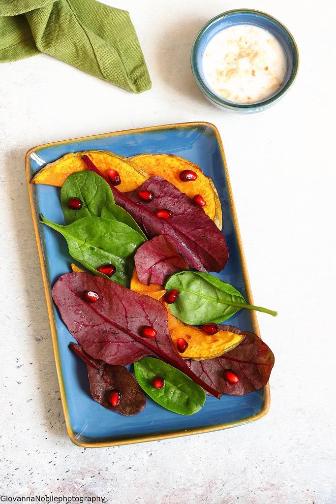 Insalata con zucca, spinacini e melagrana