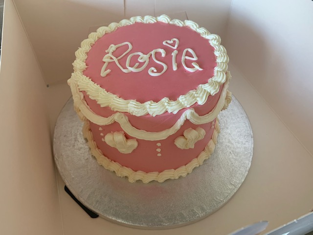 Vintage sponge cake, with pink and white buttercream icing