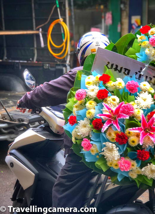 Above photograph shows a bike rider picking up huge bouquet of flowers for delivery. While in Bangkok market, you would lot of bikes/cars parked which are there to pickup stuff booked by different customers of Pak Khlong Talat market. Some of the deliverables were huge in size and we were wondering how they would reach their customers from the market, but I guess there are easier ways to do so for folks who are running this business in Pak Khlong Talat for many years now.     Related Blog-post : Buddha in the Banyan Tree and other temples at Ayuthhaya || 10-day vacation in Thailand (Day-3 Continued)
