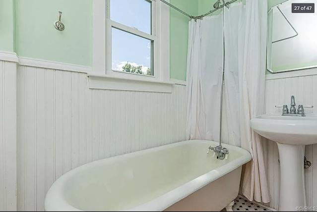 color photo of clawfoot tub period bathroom