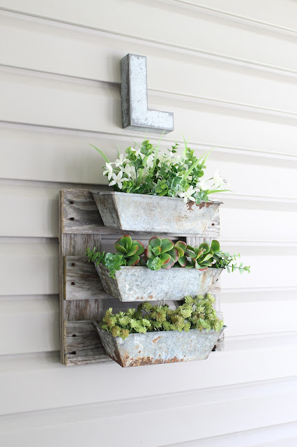 a finished DIY pallet board project using turpentine boxes and salvaged pallet pieces