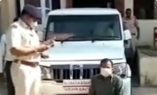 न्यायधीश प्लेट लगे बुलेरो वाहन मे अवैध शराब की पेटियों को पुलिस ने किया जप्त