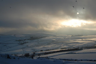 Deep snow drifts across Yorkshire hills.
