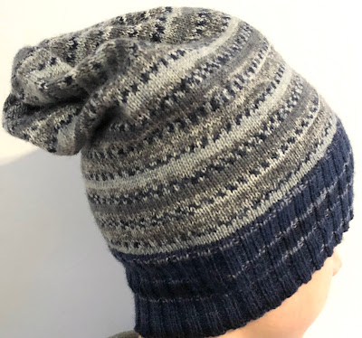 Hat knitted with DROPS Fabel Winter and Deep Ocean