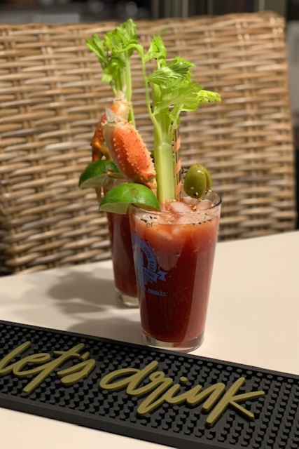 Big Bloody Mary cocktail with shrimp and celery.