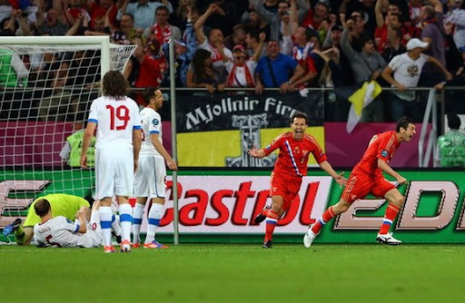 Russia player Alan Dzagoev celebrates scoring their opening goal against Czech Republic