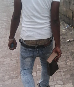 christian boy in sagging with bible
