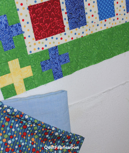 solid blue and a dotted blue fabric