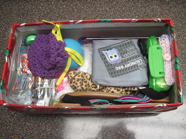 Adding a third layer of gifts to an OCC shoebox.