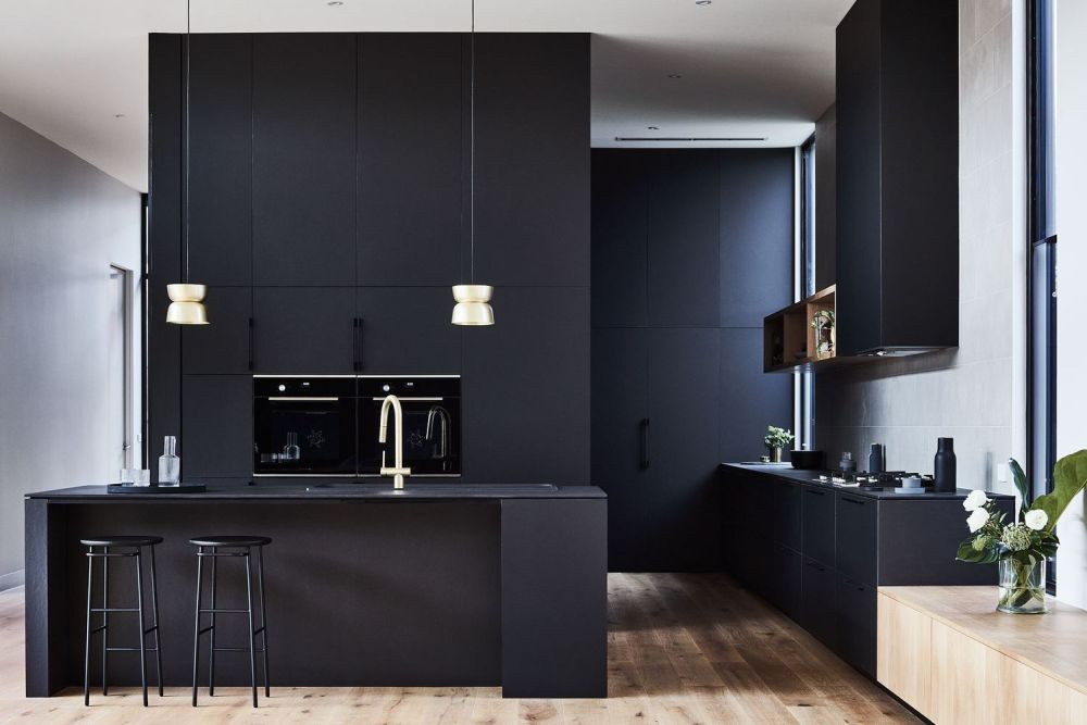 Full black kitchen decor with island and built in appliances