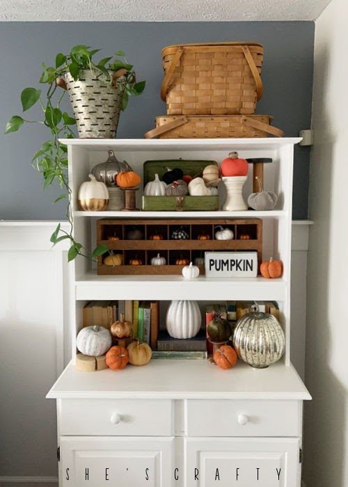 How to decorate a hutch with pumpkins and fall decor.
