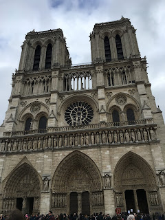 traveling solo female woman wanderlust europe backpack paris france notre dame