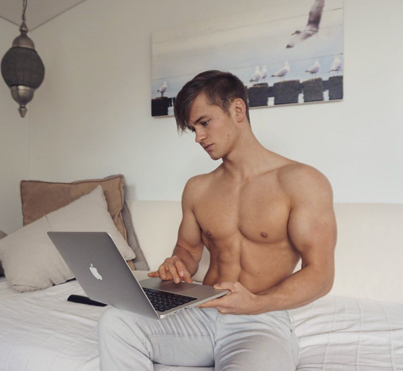 hot-guys-work-from-home-laptop-shirtless-fit-body