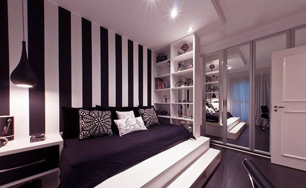 kamar tidur dengan desain dinding garis garis rancangan