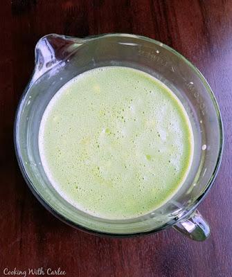 bowl of green scrambled egg mixture