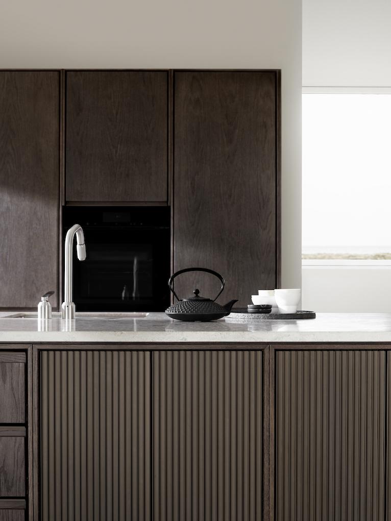 kitchen by VIPP in dark oak and jura marble