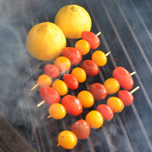 Tomatoes and lemons grilling on GrillGrates
