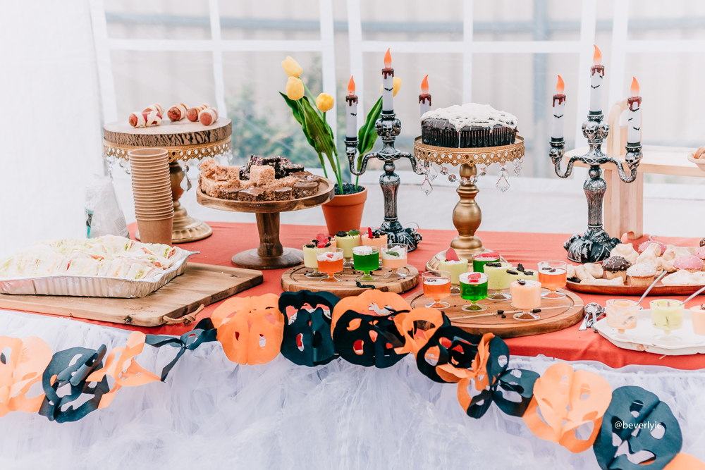 savory finger food in a halloween birthday party table