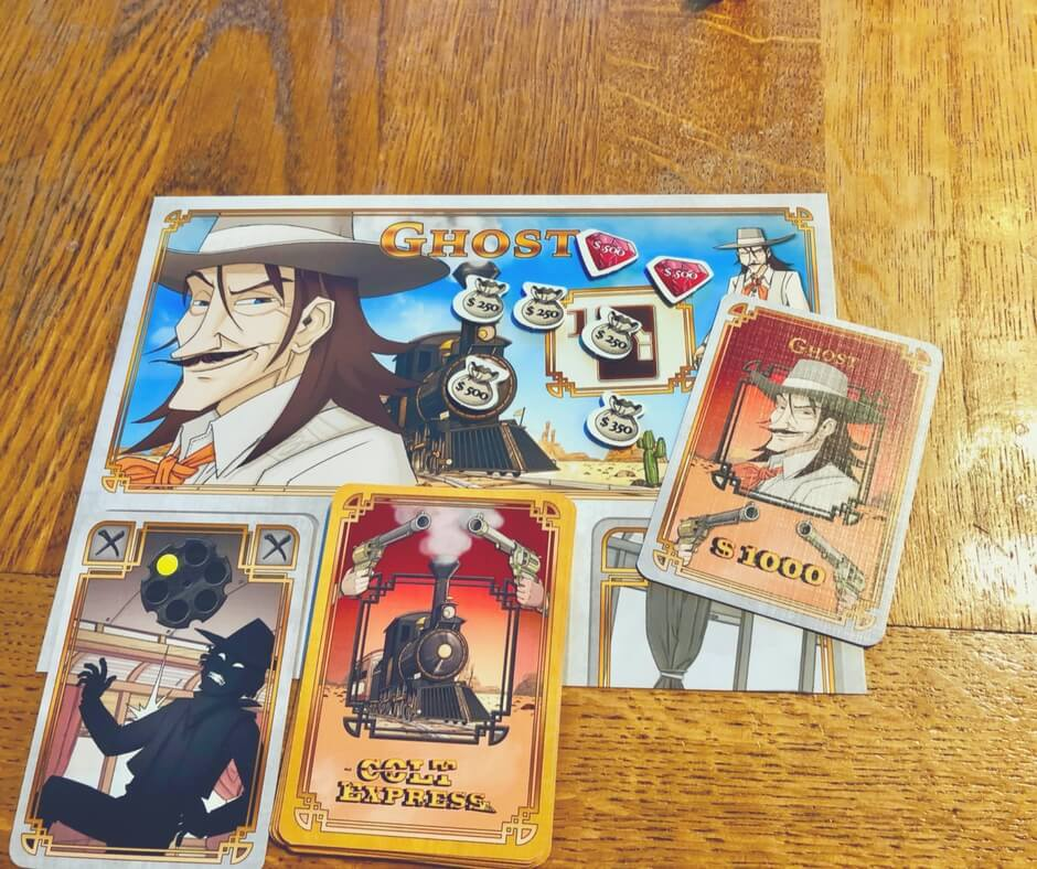 Colt Express winning player board for Ghost, has lots of money bags, diamonds, and the bonus shooting card.