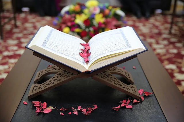 The Messenger and the believers all believe in the Quran