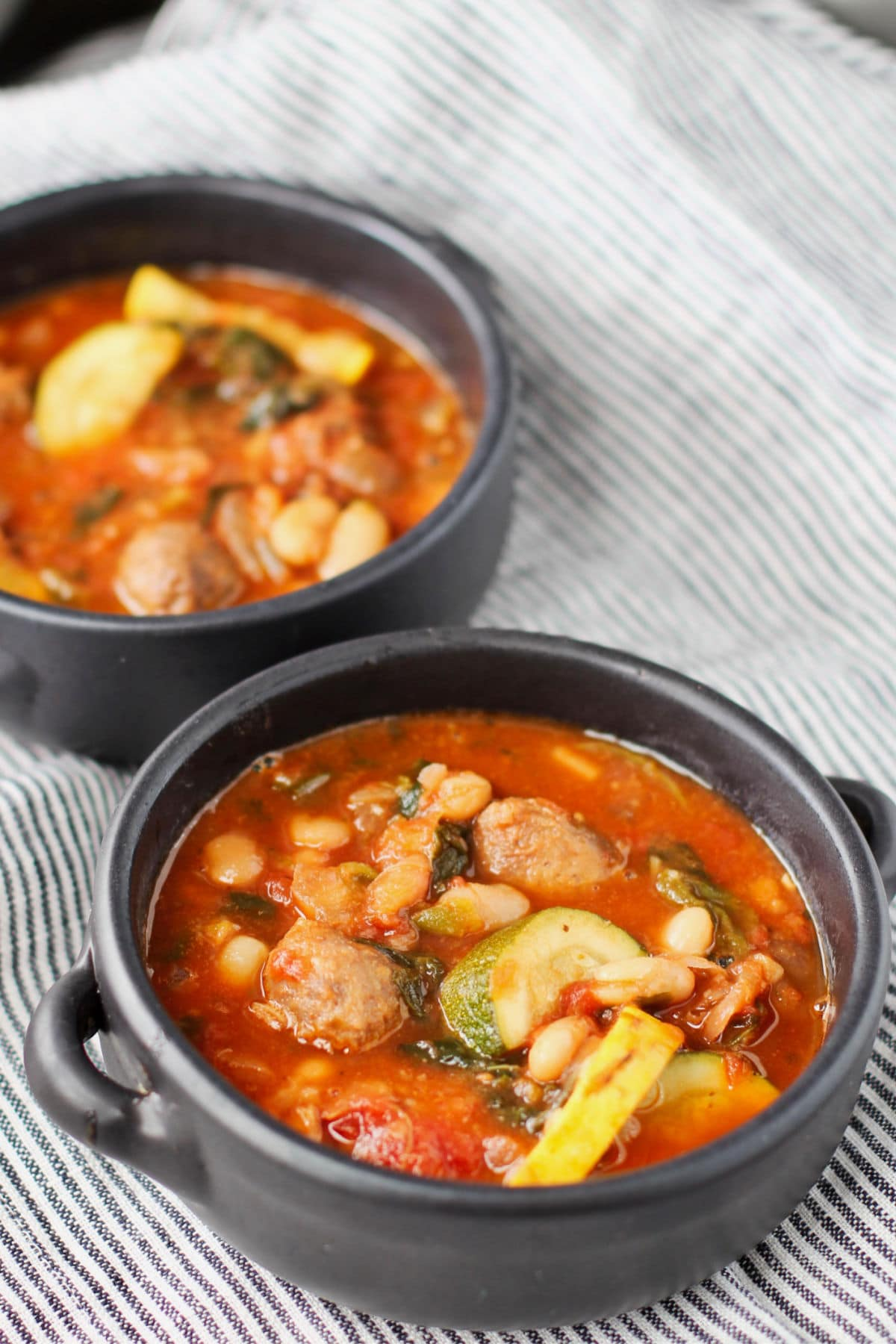 Sausage, Vegetable, and Bean Soup in a bowl.