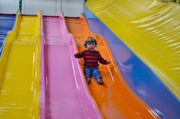 jungle jims, quex, soft play, toddler on slide