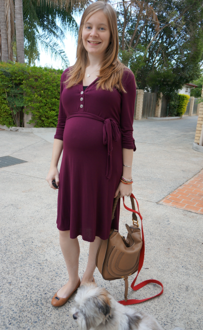 Pink Blush Maternity button sash maternity dress in burgundy with brown bag tan shoes