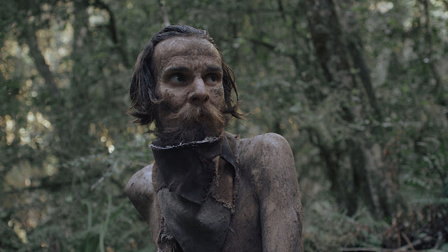 muddy man in the wilderness