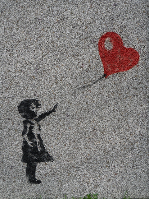 girl with balloon letting go