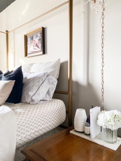 gold bed in gray bedroom