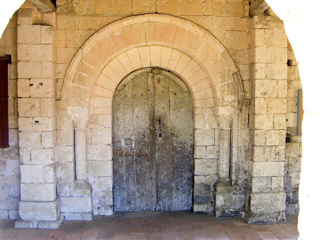 Romanesque doorway, Saint Martin's Church, Marce sur Esves.  Indre et Loire, France. Photographed by Susan Walter. Tour the Loire Valley with a classic car and a private guide.