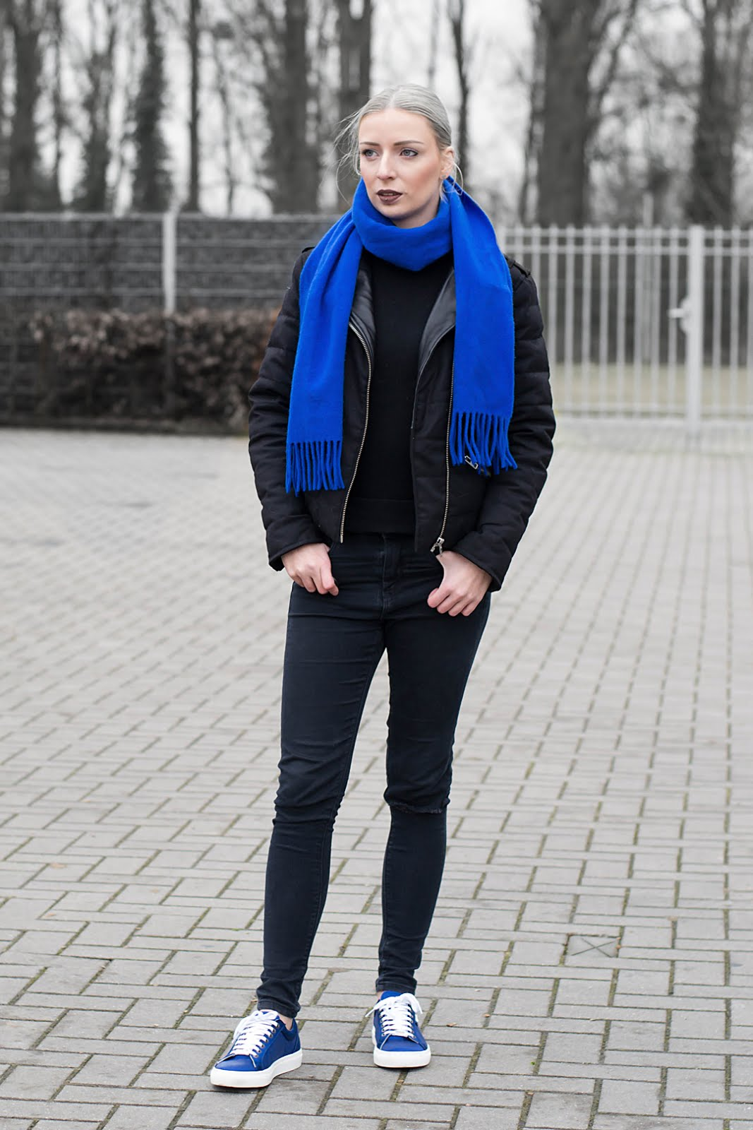Black Outfit, cobalt blue accessoiries. Wearing karl lagerfeld sneakers and the kooples jacket