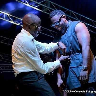 Governor Adams Oshiomhole has been spotted on stage with singer Timaya at a victory party.