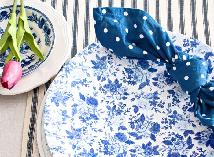blue and white decoupage chargers