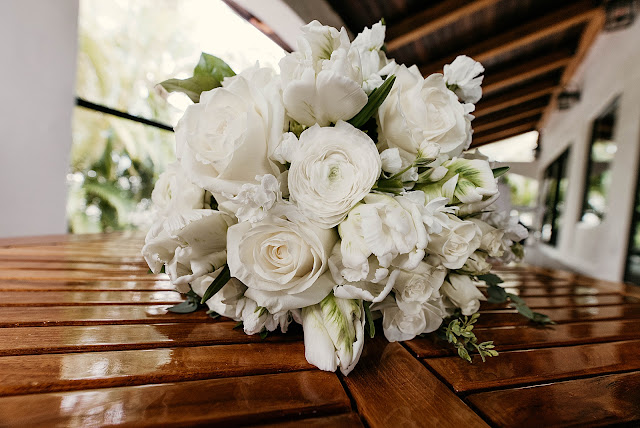 Detail shot of white bouquet on the table The Manor on St Lucie Crescent Wedding captured by Stuart Wedding Photographer Heather Houghton Photography