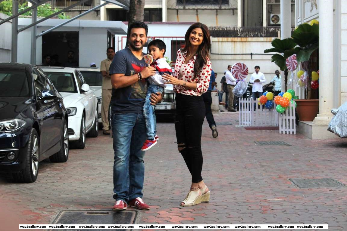 Shilpa Shetty and her husband Raj Kundra pose for photographers during their son Viaans th birthday bash