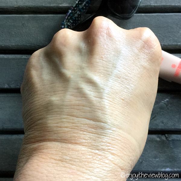 Tarteguard 20 Tinted Moisturizer in Medium blended in on the back of a hand