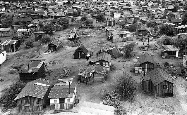 1930s shacks in a poor shanty town, an aerial view photograph