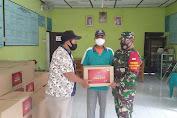 Babinsa Wonosari Amankan Penyaluran Bantuan  Sembako Dari Kabupaten