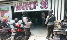 Anggota Brimob Bawa Senjata Serukan Pentingnya Pakai Masker
