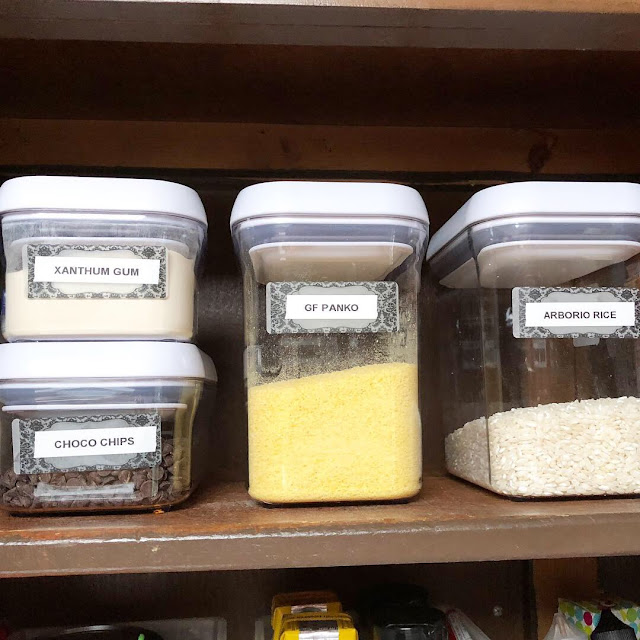 an organized kitchen pantry with baking ingredients in oxo containers