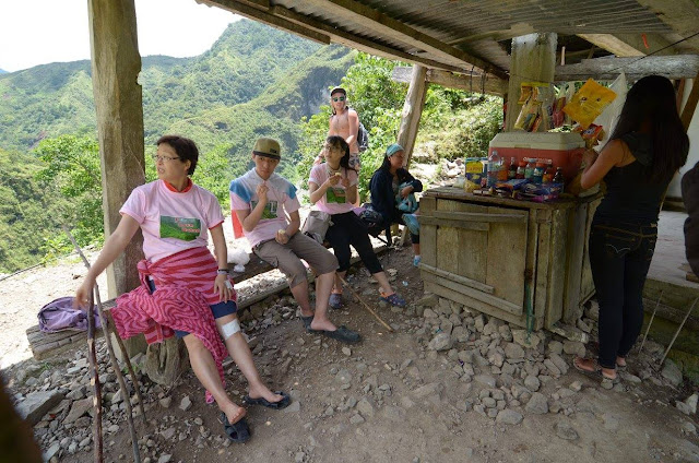 Refreshed Tourists at a Batad Store Enjoying the Cool Shade