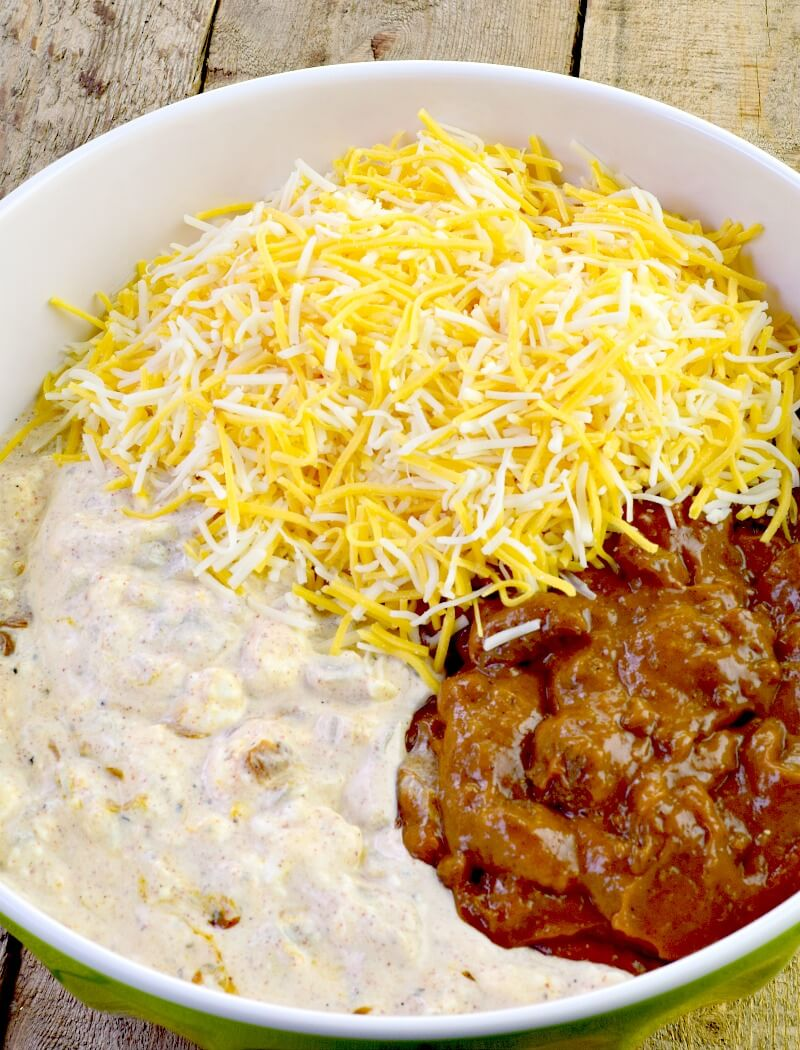 Low-Carb Texas Trash Dip - The wildly popular Texas Trash Dip gets an update in this low carb version. All of the flavor, thanks to Mexican spices and chopped roasted green chiles, with a creamy, cheesy, chili mix, makes for a delicious dip for your next party or game day that is a definite crowd pleaser! #appetizer #dip #Texas #cheese #easy #recipe #lowcarb #keto | bobbiskozykitchen.com