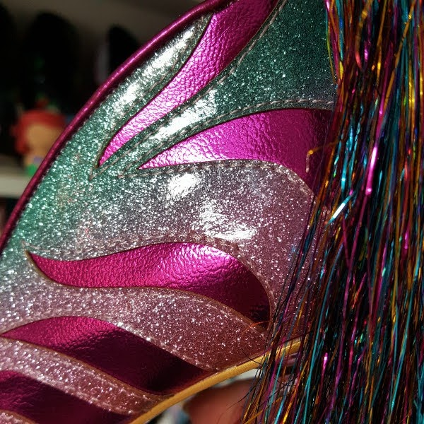 close up of smooth glitter uppers of shoes in pink and mint green