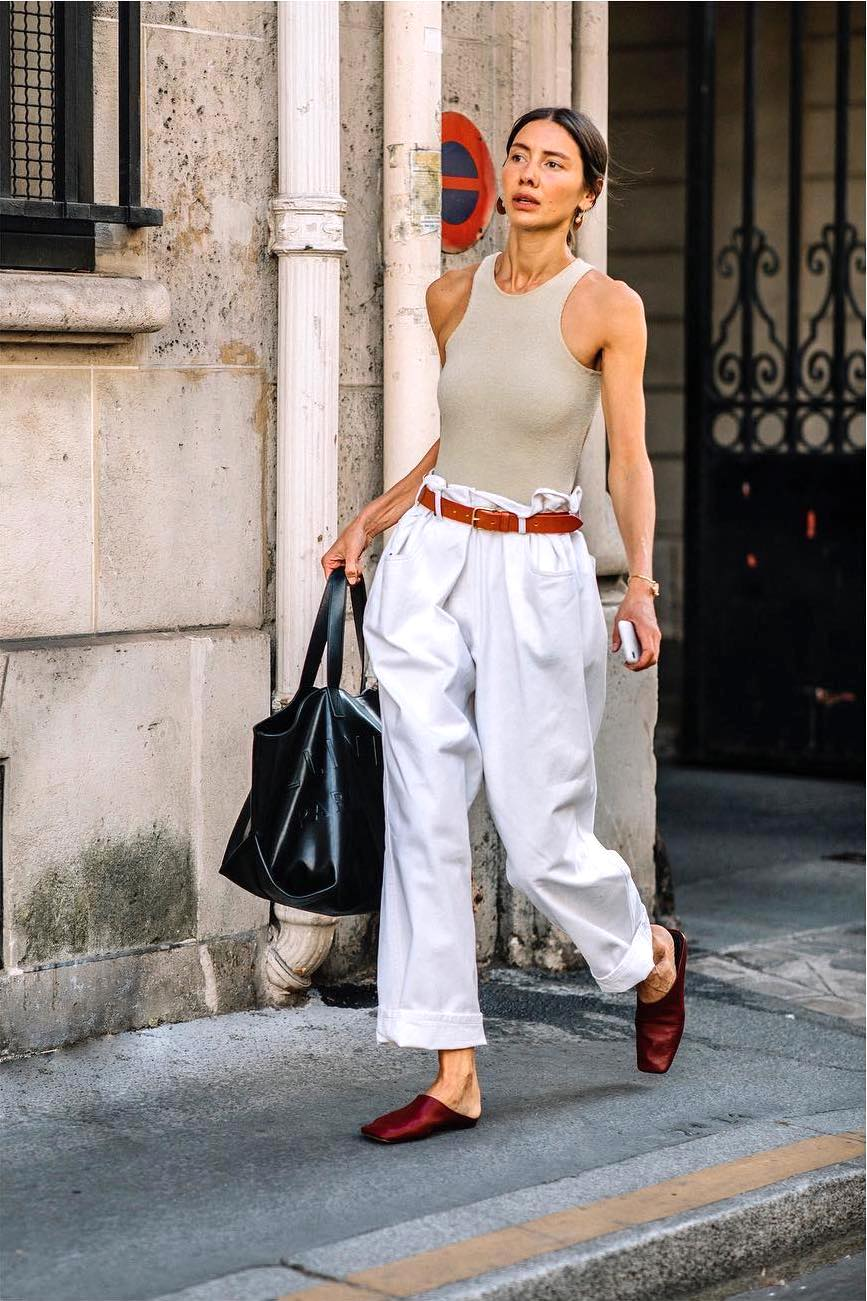 25 Best Racerback Tank Tops Trending for Summer 2021 — Julie Pelipas Street Style Outfit With Beige Top and Paperbag Pants