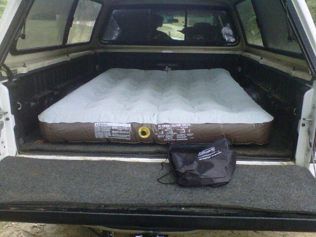 Roadworthy Wanderers Sleeping In Back Of Pickup Camper Shell