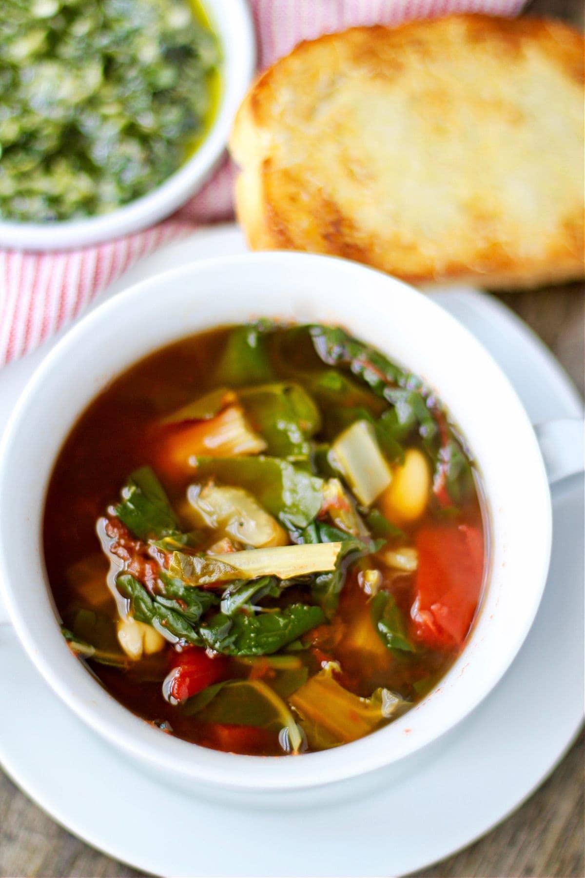 Pesto soup with bread.