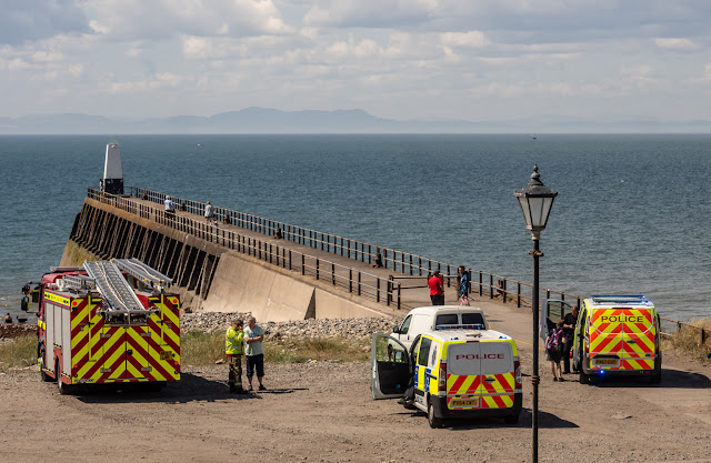 Photo of emergency vehicles parked by Maryport pier